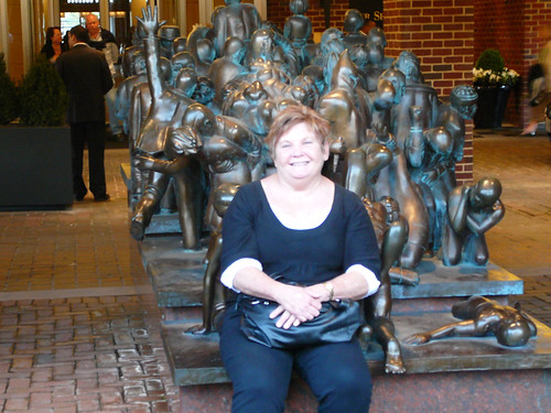 Auntie Sue waits for the hop on hop off bus using the statue as a seat