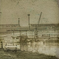 Pastcard (PhatCamper) Tags: street camera sunset reflection building cars texture water monochrome car sepia architecture canon vintage buildings river spring funny flickr hungary industrial cityscape crane urbandecay text machine naturallight cranes equipment textures machinery slovensko slovakia parked machines shipyard duna sziget ungarn danube smalltown canond30 skoda donau hungarian irfanview magyarorszg szlovkia komrom slowdown 500x500 canoneos30d rvkomrom pseudohdr komrno dunapart hajgyri szpia donauradwanderweg singlerawtonemapped phatcamper lesbrumes