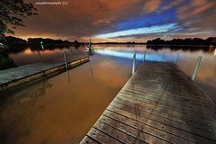 Blue Skylash at Dawn :o) (Ragstatic) Tags: longexposure morning color water sunrise relax dawn lights pier boat nikon singapore exposure nocturnal rags calm explore serene nocturne dri d700