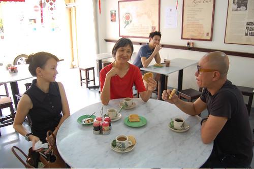 Meiling Hom drinks kopi with Singaporean art guides.jpg