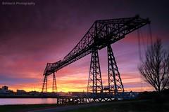 Skyline (~Glen B~) Tags: bridge blue sunset red orange silhouette yellow dusk middlesbrough transporter rivertees portclarence