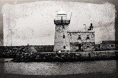Bringing Back Sea Memories (tochis) Tags: autumn ireland sea blackandwhite bw howth dublin lighthouse cold fall texture pier europe harbour postcard windy oldphoto ie 1001nights flickraward dubstatic