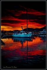 hell is coming ;-) (Muchilu) Tags: red sun 3 hot sol set de puerto harbor boat rojo nikon barco d hell ps ibiza reflect nubes reflejo land cs 105 eivissa 18 scape puesta 90 soe vr infierno d90