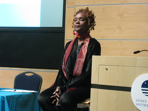 Rha Goddess listens at WISE conference by you.