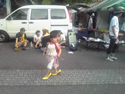 Little girl wearing mom's shoes