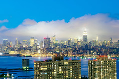 the blue hour fog bank (mudpig) Tags: newyorkcity longexposure sunset newyork fog skyline night geotagged newjersey jerseycity cityscape nightscape dusk manhattan newport esb hudsonriver empirestatebuilding hdr pavonia hollandtunnel mudpig stevekelley