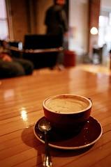 Dark Horse Latte (Georgie_grrl) Tags: toronto ontario coffee cafe downtown pentaxk1000 coffeehouse latte caffeine spadinaavenue darkhorseespresso cans2s rikenon12828mm