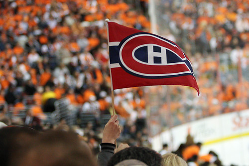A lone Montreal Canadiens flag raised high in the midst of the Philadelphia Flyers fans