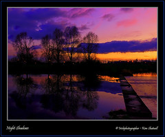 Night Shadows (Irishphotographer) Tags: autumn trees sunset sky irish lake tree art beach nature water sunshine night sunrise naked nightshot native shoreline shore irishbeach sureal skys hdr irishart kinkade movingwater supershot firstdayofwinter burningskys beautifulireland hdrunlimited nakedbeauty irishphotographer besthdr imagesofireland craigavonlakes pentaxk20d skyascanvas kimshatwell irishphotographerkimshatwellireland craigavoncoarmagh craigavonwatersportscentre irishcalender irishcalender09 irishphotographer breathtakingphotosofnature beautifulirelandcalander wwwdoublevisionimageswebscom