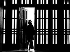 Ci Pastwo wanie wychodz (Adam Olszaski) Tags: light people bw glass dark out doors going wrocaw