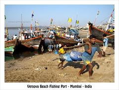 Versova Beach Fishing Port (AdreWine) Tags: india boats fishermen ships flags bombay bom mumbai fishingport versovabeach