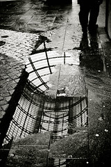 walking in Milan (Fotis ...) Tags: street wet rainy waterreflection