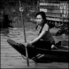 beauty & the boat (fateless_gypsy) Tags: poverty light shadow portrait bw woman lake boat blackwhite fishing asia cambodia village floating rowing siemreap tonlesap