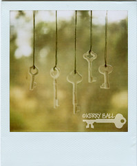 porcelain keys. ((Kerry Ball)) Tags: keys polaroid key polaroids 600film skeletonkeys sx70sonar hangingbyastring hangingseries porcelainkeys