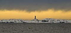 Svenner zoomed (mrpb27) Tags: sky lighthouse snow norway geotagged island coast norge nikon fjord fyr snø larvik kyst svenner mrpb27 d40x 18200mmf3556gedifafsvrdx eftang geo:lon=10139179 geo:lat=59009368 andebakken