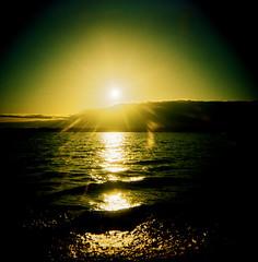 When Water Comes To Life (liquidnight) Tags: seattle park sunset sun sunlight colour green 120 film beach water sunshine yellow clouds mediumformat gold holga xpro waves kodak horizon slidefilm shore crossprocessing pugetsound ektachrome discoverypark expiredfilm ektachrome64 120cfn epr 111999