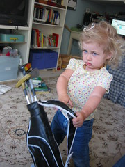 With her new golf clubs she requested (as surly as she looks here)