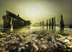washed out (stocks photography) Tags: sea england copyright seaweed beach water coast kent stones jetty atmosphere pebbles stocks viewlarge whispers magical tidal whitstable washedout seaofsouls stocksphotography canon5dmk11