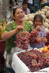 Grape seller, market, Cobán, Guatemala