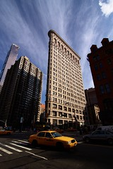 Flatiron Building (Gwenal Piaser) Tags: new york nyc usa newyork building skyscraper canon eos 2000 angle manhattan wide july wideangle tokina 600 400 300 500 5000 700 grattacielo 3000 800 canoneos 2009 flatiron 1000 900 116 6000 immeuble 8000 atx 4000 gratteciel 7000 50d  eos50d canoneos50d 1116mm unlimitedphotos flickrbestpics tokina1116mmf28 tokinaaf1116mmf28 atx116prodx gwenflickr