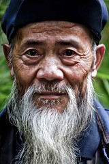 Wise Old Man (Paul Cowell) Tags: china blue portrait beard uncle character oldman cap wise chengdu tibetan aged grandad sichuan wrinkles yaan bluecap whitebeard  paulcowell bluecaptibetanchina