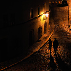 Night Walk (flofler) Tags: shadow lowlight couple prague streetlamp availablelight cobblestone squareformat czechrepublic nightwalk czechia nikond300