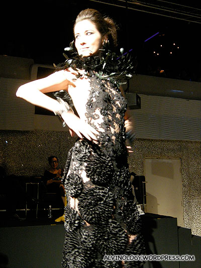 The emcee modeling a lacey black gown herself