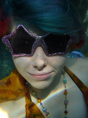 Starry eyed (Megan is me...) Tags: camera pink light portrait orange sun water pool smile sunglasses glitter digital swimming self reflections hair effects photography star glasses necklace beads rainbow eyes colorful neon pretty colours underwater dress bright shaped turquoise meg under megan bubbles olympus special bubble stylus colored sw freckles atomic glittery punky lampwork 770 dyed napalm refractions tiffys