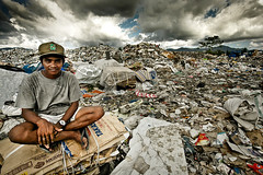 Life in the Dumpster (jeridaking) Tags: poverty life portrait sky people smile clouds trash asia southeastasia angle philippines poor wide dump cap sit area basura carton filipino folks ralph pinoy visayas leyte ormoc bisaya danhug bisdak poorest ormocanon jeridaking macabug matres fortheloveofphotography leytephotographer ormocphotographer