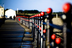 Railings (Dave G Kelly) Tags: ireland winter red sky black seaside interestingness dof explore seafront wicklow railings bray sigmalens sigma70200 sigmaapo70200mmf28exdghsm