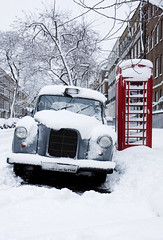 London Snow (Daniel R Silva) Tags: street city winter england urban white snow london english ice weather phone britain snowy cab taxi great british telephonebox snowday snowscene icey