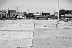 Parking lot & Bus - 18Jun09, Memphis (USA) (philippe leroyer) Tags: blackandwhite bw bus tourism fence word parkinglot post noiretblanc memphis empty parking lot tourist nb poteau deserted abandonned tourisme grillage vide dsert abandonn touriste dsert
