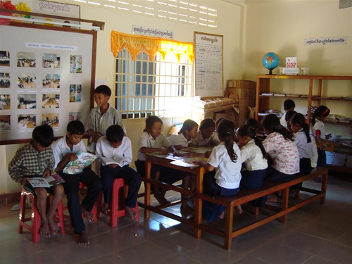 The students gather in the library to read and play games.