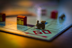 Advance To Go (michaeljosh) Tags: train bokeh monopoly boardgame nikkor50mmf14d project365 nikond90 advancetogo mediterraneanavenue michaeljosh bronzegamepiece monopolycollectorsedition