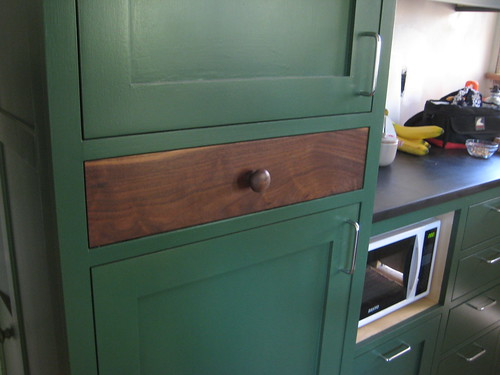 pantry drawer with walnut face
