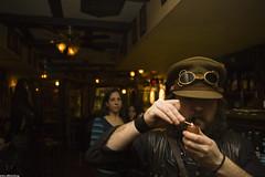 Steam Chiaroscuro (JF Sebastian) Tags: portrait costume pub pipe goggles zaragoza cap corset match smoker tobacco steampunk takenby pipesmoker nikond70s1770 sambrownebelt jorgeferrergarca morethan100visits morethan250visits morethan500visits thepenguinrow