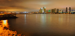 San Diego Skyline in HDR... (Seth Oliver Photographic Art) Tags: california nightphotography buildings reflections nikon nightlights skyscrapers sandiego iso400 cities cityscapes skylines nightshots southerncalifornia pinoy urbanscapes sandiegobay longexposures sandiegoskyline coronadoisland d90 nightexposures wetreflections bracketedexposures tidelandspark sandiegoatnight highdynamicrangeimages setholiver1 18105mmnikkorlens tripodmountedshot shutterspeedprioritymode croppedtopanomode multipleexposurehdrimage