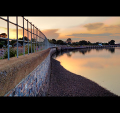 ~ Starcross Lead In ~ (Komatoes) Tags: sunset reflection water wall train 50mm nikon tracks pebbles devon railings hdr starcross d40 singlerawfile