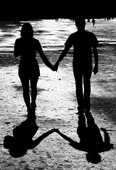 Walking. (Jake darwen) Tags: new boy white black beach wet girl silhouette reflections walking 50mm sand holding hands nikon friend shadows symmetry auckland zealand nikkor puddles d90
