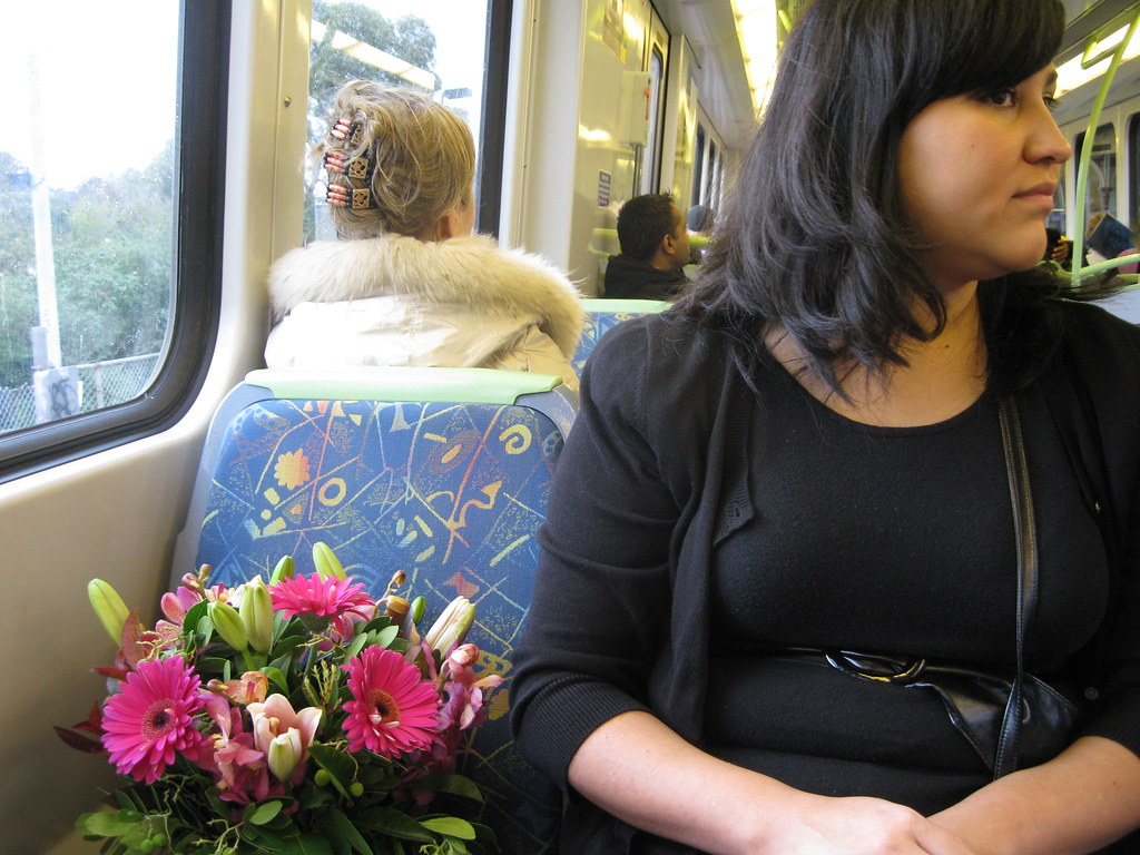 Jacqui and flowers on the train.