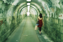 (habeebee) Tags: red woman blur green girl wall dark underpass graffiti vanishingpoint peeling hungary dress budapest tunnel tags dim passerby lightattheend angyalfld