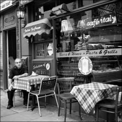 Café Italy (matteoprez) Tags: uk london 6x6 blancoynegro rollei mediumformat blackwhite fuji iso400 streetphotography camdentown biancoenero 120mm carlzeiss fujineopan epson4490 autaut fotografiadistrada matteoprezioso rolleiflex35automatmx caféitaly tessar135f75mm icantrememberfstopshutterspeeddamn