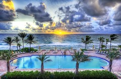 There's a pool party at sunset - everyone mark your chair with a towel (Trey Ratcliff) Tags: ocean lighting trees light sunset sea party vacation sky panorama orange sun love colors pool beautiful lines yellow yoga clouds composition swimming sunrise fun photography amazing nikon energy surf shoot waves mood photographer shot angle image florida details d2x perspective picture free wave atmosphere bbq pb romance palm oasis edge processing stunning pro romantic recreation meditation breakers framing top100 portfolio lovely capture emotions palmbeach hdr masterpiece 2007 poolparty treatment thebreakers pbi d2xs stuckincustoms treyratcliff
