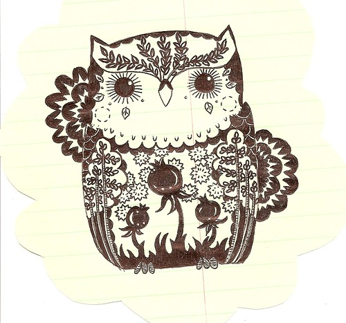 an herbal owl with pomegranates