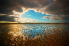 A Break in the Clouds (Semi-detached) Tags: sun sunlight reflection beach water saint st clouds corner reflections landscape march scotland andrews shine hole fife britain dunes sandy great dramatic scottish east ridge 2009 ridges neuk aplusphoto
