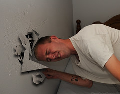 ever feel like you wanna just put your head through a wall? (SW23CT (CamsDigitalCanvas.com)) Tags: portrait selfportrait face wall smash nikon head tripod f71 headbanging rogues d300 velbon trp nikonsb400 exp1100 tamron18270mm therogueplayers bangmyheadonawall