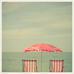 Happy Bank Holiday! (_cassia_) Tags: sea summer holiday clouds umbrella coast seaside brighton deckchair stripes parasol buoy cassiabeckcom