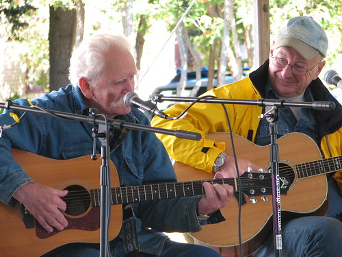 old guys singing folk songs