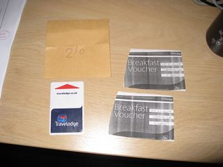 half a brown envelope with room number and two badly photocopied breakfast vouchers