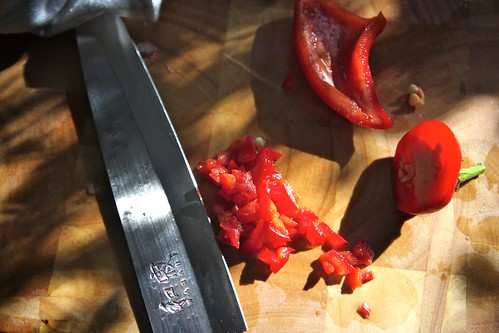 chopping a hot pepper in major sunlight